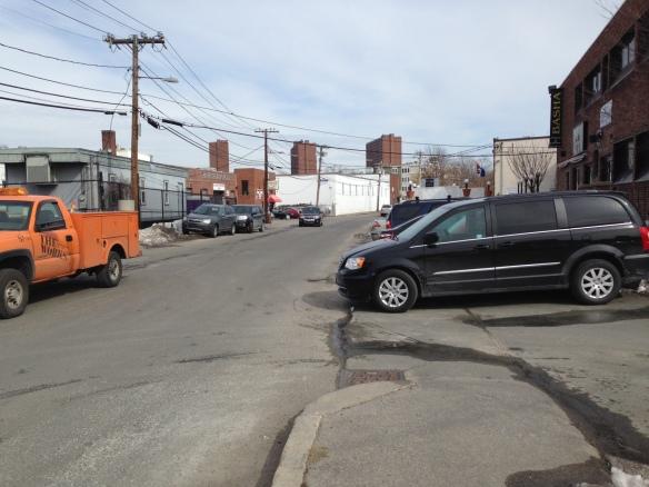 Cars regularly block the sidewalks along New Street
