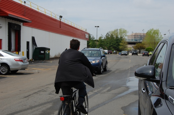 The most direct route to the T goes through a busy parking lot with no sidewalks.