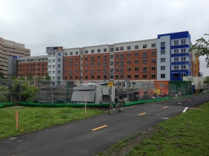 This building will offer 398 units (all 1 & 2 BRs). In the foreground another building will offer 244 units.