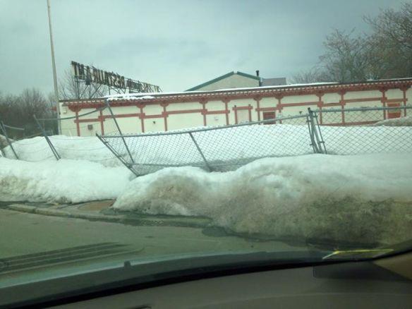 Vassal Lane frontage impassable due to unshoveled snow and leaning fence